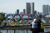 Coronavirus: टोक्यो ओलंपिक पर अफरातफरी में फैसला लेने से IOC ने किया इनकार