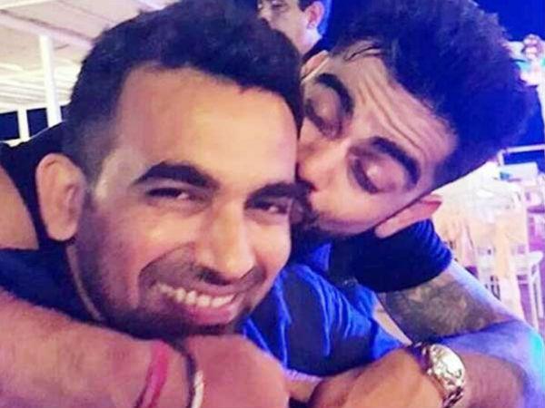 Virat Kohli kissing Zaheer Khan at the cocktail party