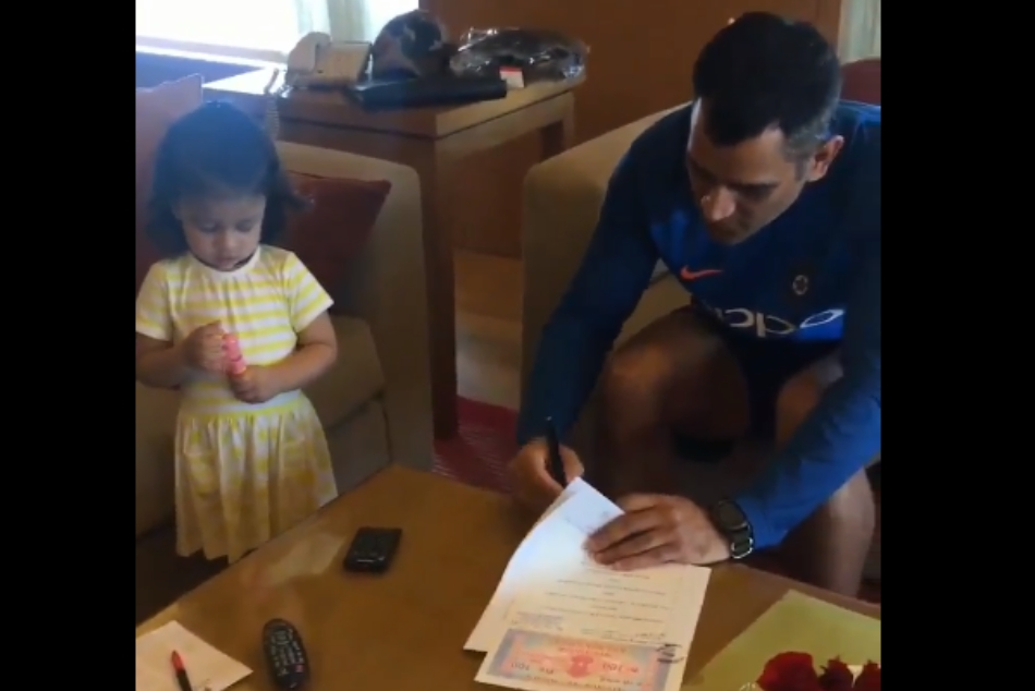 ipl 2018 player retention: mahendra singh dhoni sign stamp paper with daughter Ziva Dhoni