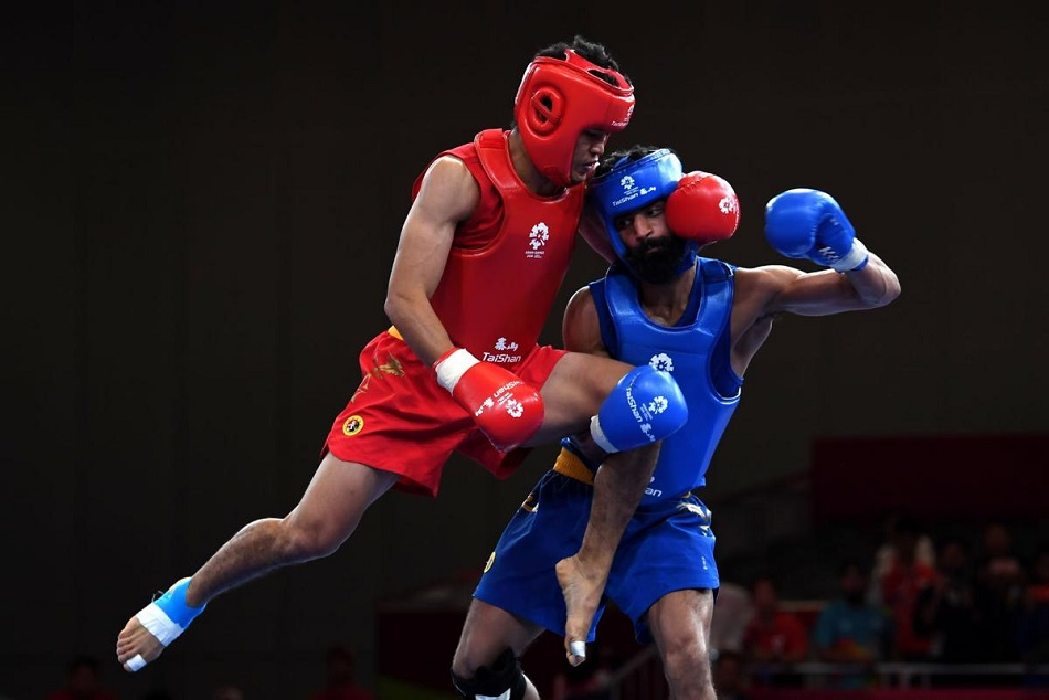 Surya Singh wins bronze in Wushu Mens Sanda 60 kg event
