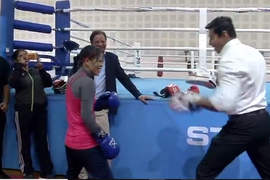Rajyavardhan Singh Rathore in a friendly boxing bout with Mary Kom
