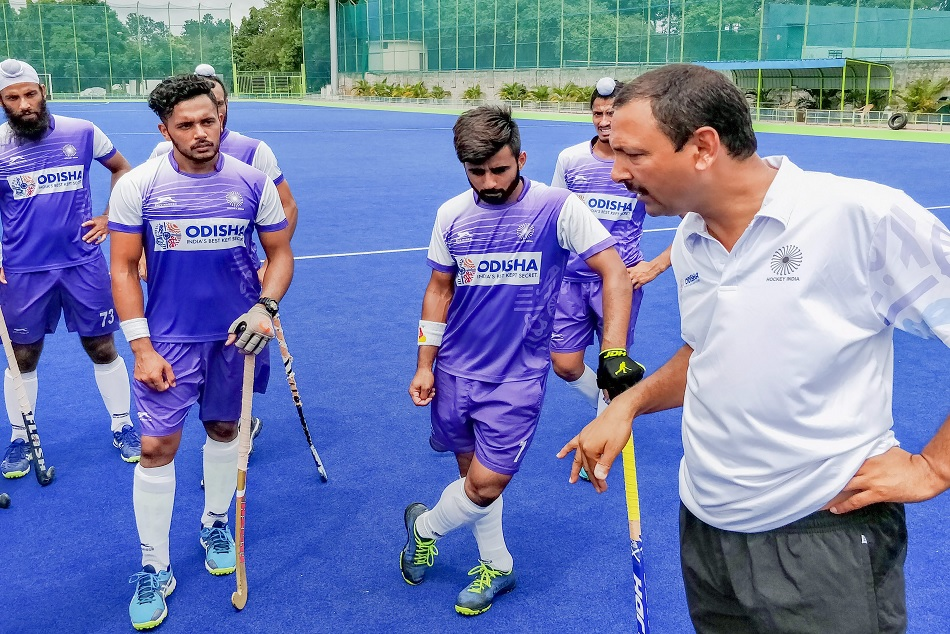 hockey mens team senior chief coach harendra singh demoted to junior hockey team