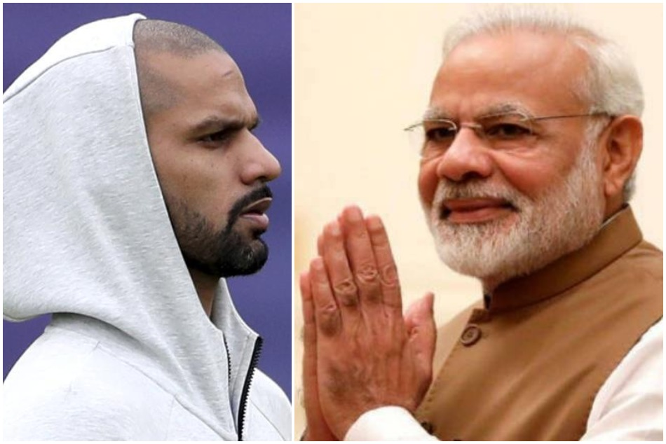 PM Narendra Modi cheers up Shikhar Dhawan after he ruled out of World Cup 2019