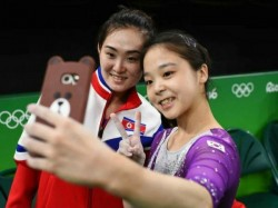 North South Korean Gymnasts Pose Olympic Selfie
