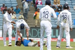 India Vs South Africa 2nd Test Security Breach In Pune Fan Invades Pitch To Touch Rohit Sharma Feet