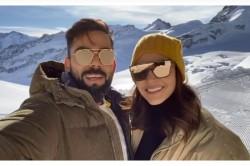Virat Kohli And Anushka Sharma Wishes New Year From Switzerland Watch