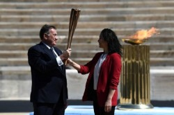 Olympic Torch Reaches Tokyo From Greece Event Held In Closed Doors Without Audience